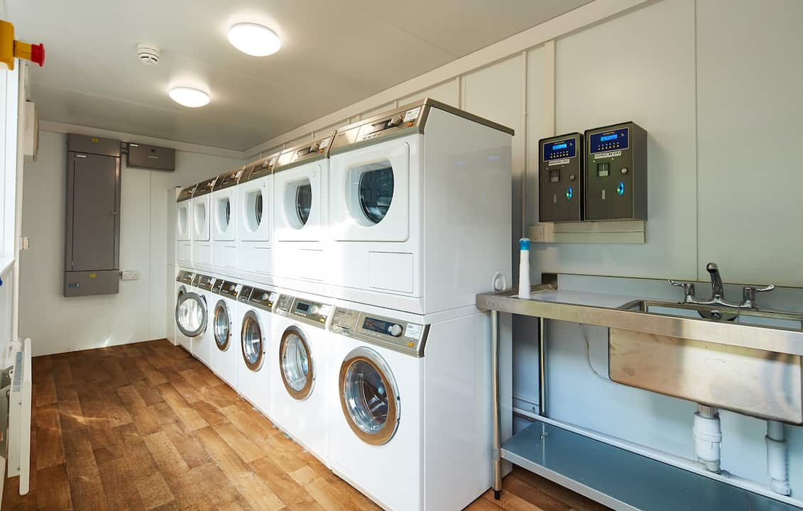 Laundry room within shipping container housing development at Meath Court