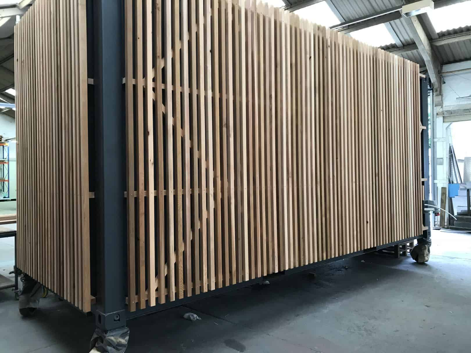 Cedar cladding on the side of a shipping container cafe conversion